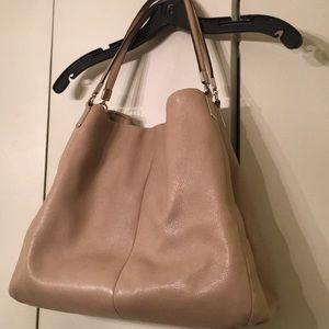 Large size Coach handbag.